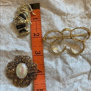 3 gold tone costume jewelry brooches
